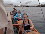 smiling travelers on Captain Kiko's double canoe